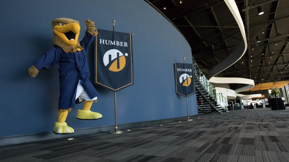 Howie The Hawk celebrates Humber convocation.