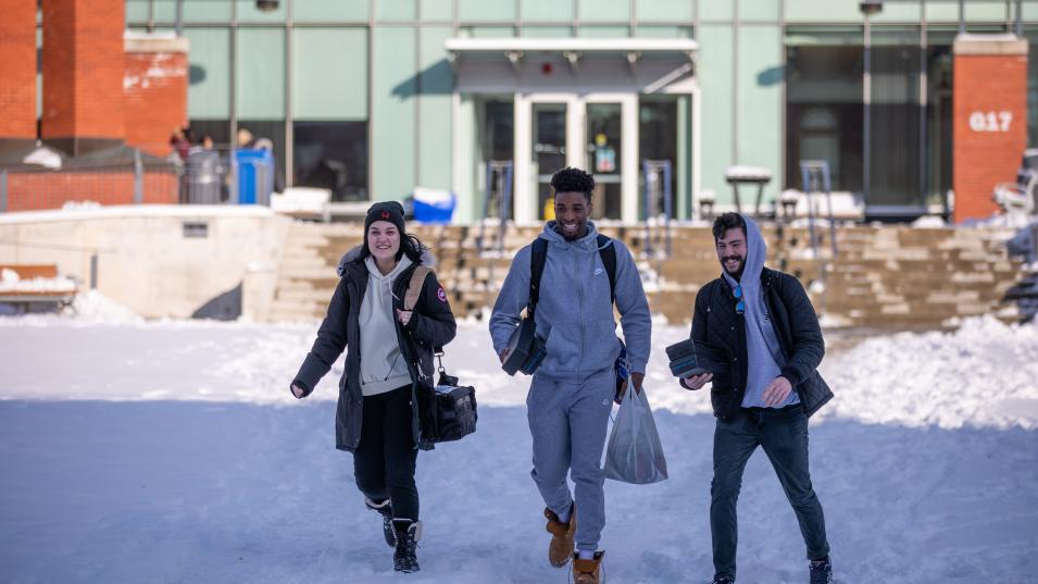 Humber students walk through the snow at Lakeshore Campus.